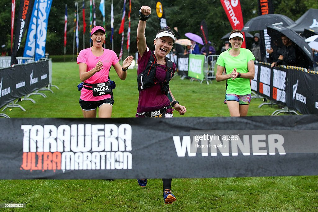 Fiona Hayvice of New Zealand celebrates while crossing the finish line to win the Tarawera Ultramarathon on February 6, 2016 in Rotorua, New Zealand.