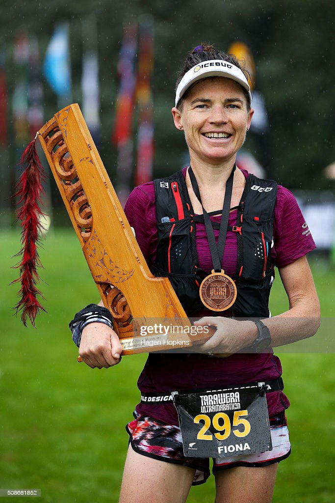 Fiona Hayvice of New Zealand celebrates with the winner's trophy after winning the Tarawera Ultramarathon on February 6, 2016 in Rotorua, New Zealand.