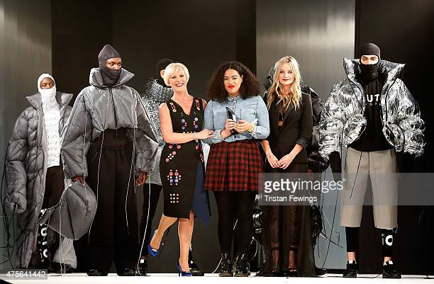 Fiona Lambert with the winner of the George Gold Award Hannah Wallace and Laura Whitmore on day 4 of Graduate Fashion Week at The Old Truman Brewery...
