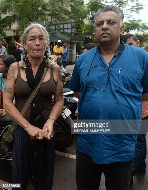 Fiona MacKeown mother of murdered British schoolgirl Scarlett Keeling and her lawyer Vikram Varma look on after leaving the Childrens Court in Panaji...