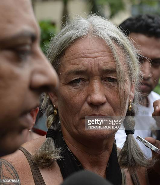 Fiona MacKeown mother of murdered British schoolgirl Scarlett Keeling looks on as her lawyer Vikram Varma speaks after leaving the Childrens Court in...