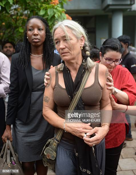 Fiona MacKeown the mother of murdered British schoolgirl Scarlett Keeling is escorted as she leaves the Childrens Court in Panaji on September 23...