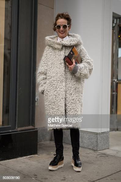 Fiona McCarthy is seen on Michigan Avenue wearing Stella McCartney black leather shoes and mohair and woolblend Bouclé coat Mykita glasses Burberry...