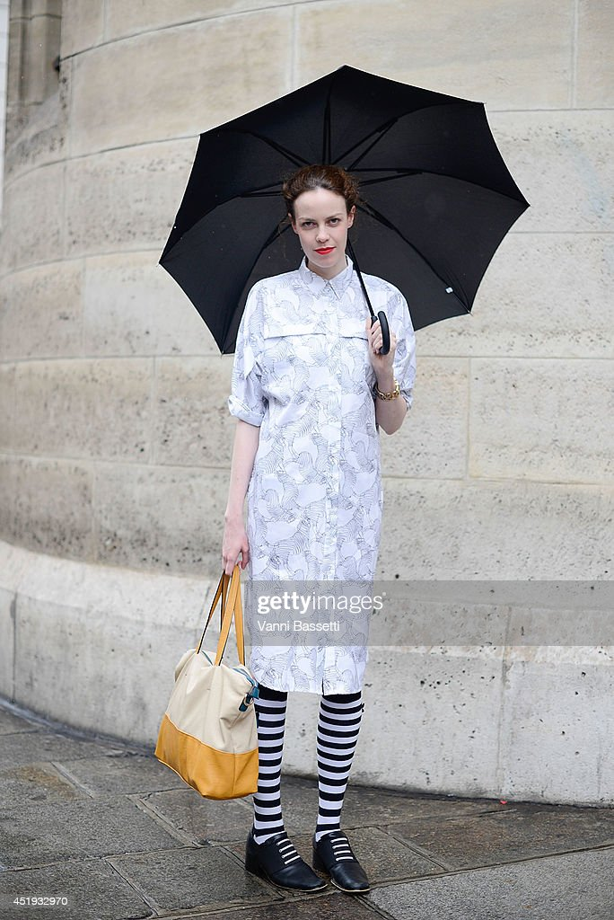 Fiona McKay poses wearing an Asos dress, Nine West shoes and Go Blinking bag before Jean Paul Gaultier show on July 9, 2014 in Paris, France.