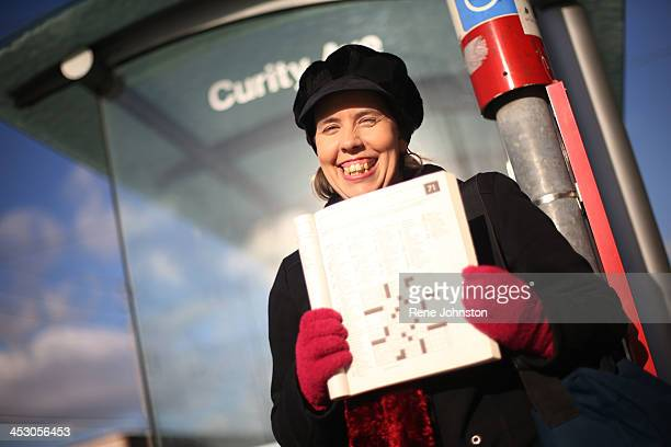 Fiona Newman avid crossword solver shows a puzzle at a bus stop Dec 21 is the 100th anniversary of the first crossword puzzle It appeared in the New...