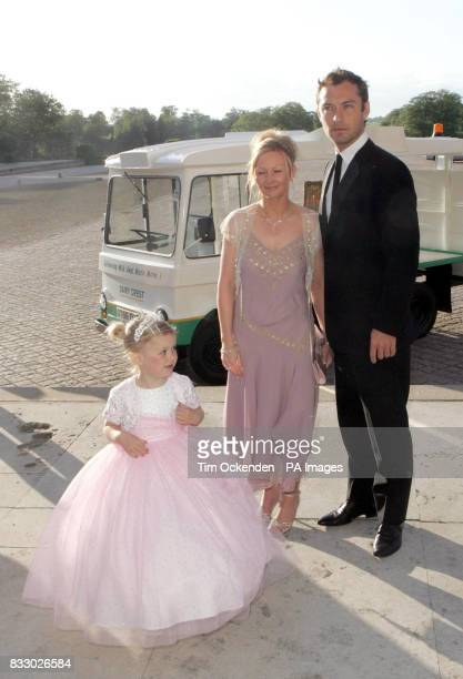 Fiona Sterling and daughter fiveyearold Ellie stand with film star Jude Law during the Make a Wish Foundation annual ball at Blenheim Palace...