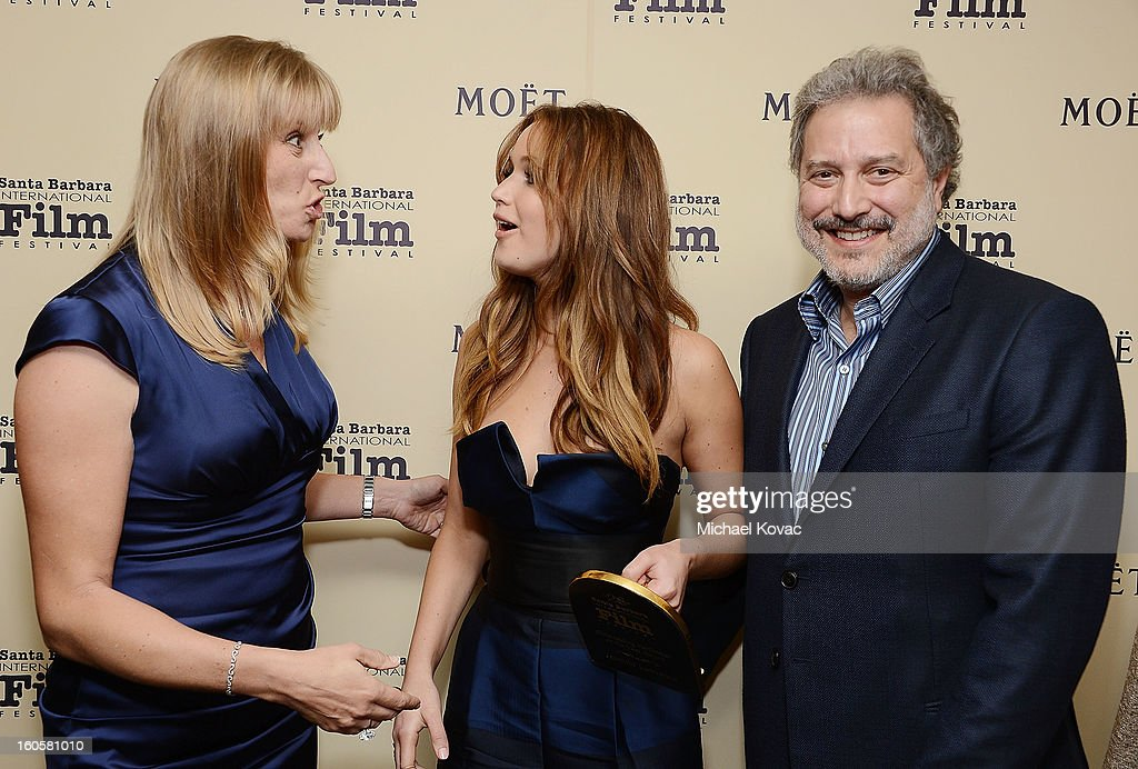 Fiona Stone, actress Jennifer Lawrence, and SBIFF president Douglas Stone visit The Moet & Chandon Lounge at The Santa Barbara International Film Festival on February 2, 2013 in Santa Barbara, California.