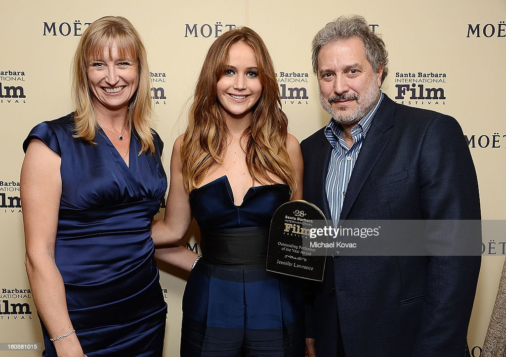 Fiona Stone, actress <a gi-track='captionPersonalityLinkClicked' href=/galleries/search?phrase=Jennifer+Lawrence&family=editorial&specificpeople=1596040 ng-click='$event.stopPropagation()'>Jennifer Lawrence</a>, and SBIFF president Douglas Stone visit The Moet & Chandon Lounge at The Santa Barbara International Film Festival on February 2, 2013 in Santa Barbara, California.