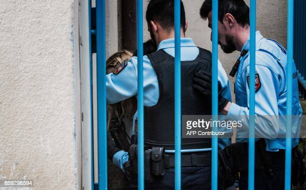 Fiona's mother Cecile Bourgeon is escorted by gendarmes on October 9 2017 as she arrives in Le Puy en Velay court room on the opening day of the...