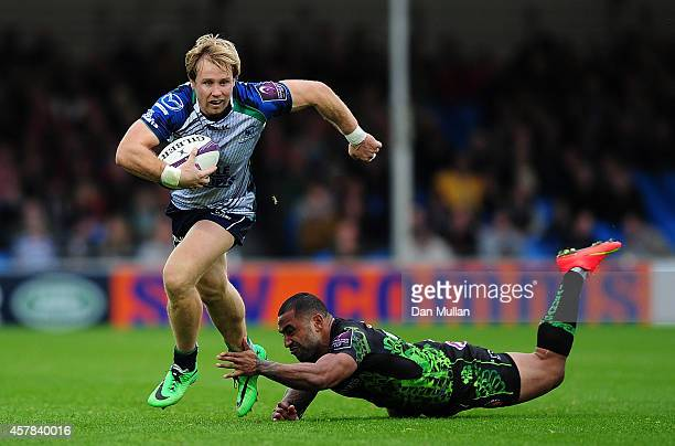 Fionn Carr of Connacht makes a break past Fetu'u Vainikolo during the European Rugby Challenge Cup match between Exeter Chiefs and Connacht at Sandy...