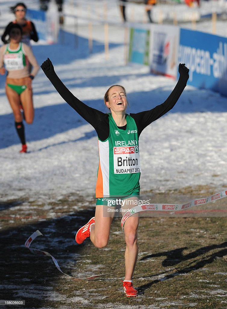 Fionnuala Britton of Ireland celebrates as she crosses the finish line to win the Senior Women's race during the 19th SPAR European Cross Country Championships on December 9, 2012 in Budapest, Hungary.