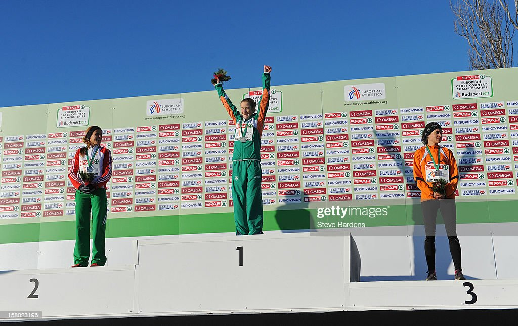 Fionnuala Britton of Ireland celebrates with her gold medal on the podium after winning the Senior Women's race during the 19th SPAR European Cross Country Championships on December 9, 2012 in Budapest, Hungary.