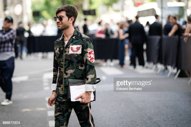 Fiora Filippo wears sunglasses and a military camo outfit outside the Valentino show during Paris Fashion Week Menswear Spring/Summer 2018 on June 21...