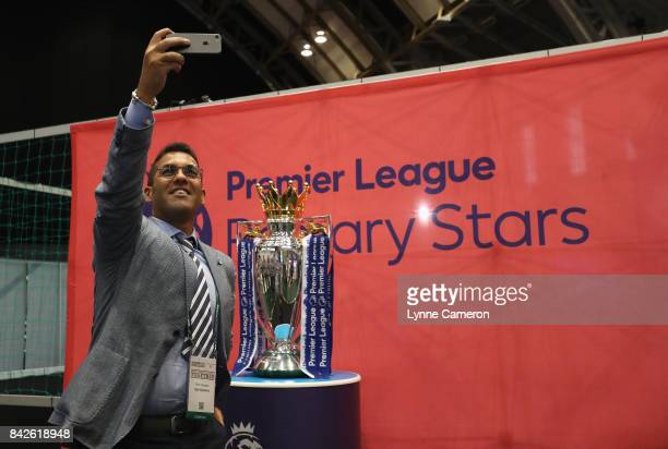 Fiore Capasso takes a selfie with the Premier League trophy during day 1 of the Soccerex Global Convention at Manchester Central Convention Complex...
