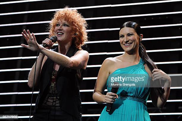 Fiorella Mannoia and Laura Pausini perform at the charity concert 'Amiche Per L'Abruzzo' on June 21 2009 in Milan Italy