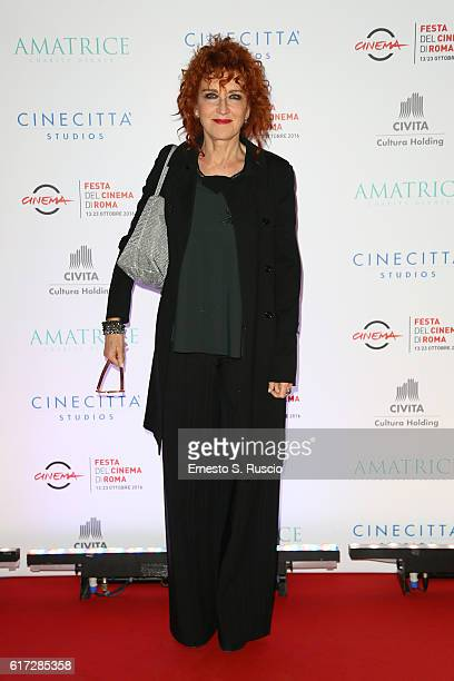 Fiorella Mannoia walks a red carpet at the charity dinner for Amatrice during the 11th Rome Film Festival at Auditorium Parco Della Musica on October...