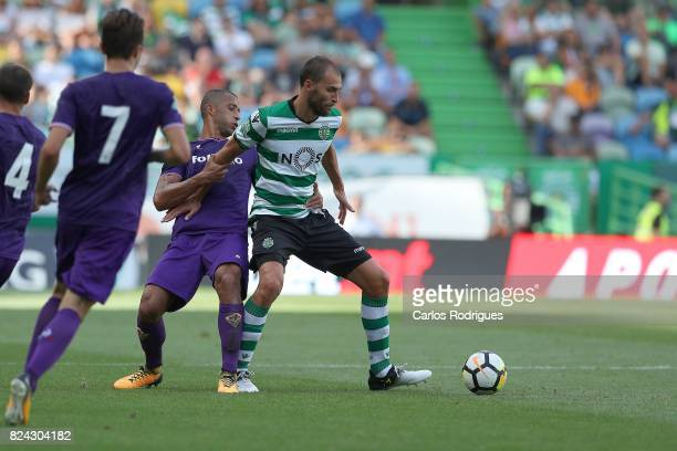 Fiorentina defender Vitor Hugo from Brazil tries to stop Sporting CP forward Bas Dost from Holland during the Five Violins Trophy match between...