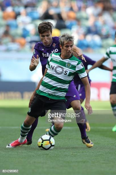 Fiorentina forward Federico Chiesa from Italy vies with Sporting CP defender Fabio Coentrao from Portugal during the Five Violins Trophy match...