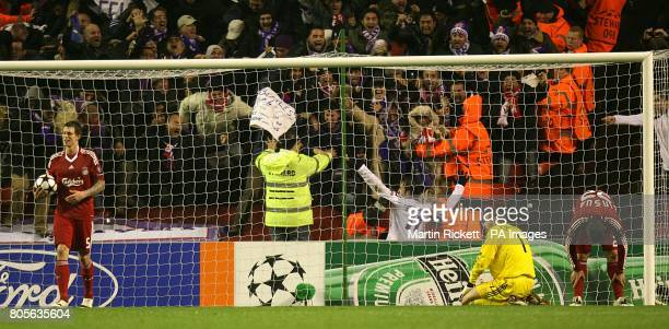 Fiorentina's Alberto Gilardino celebrates scoring his sides second goal of the game as Liverpool's Daniel Agger and Emiliano Insua stand dejected