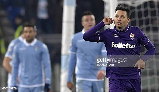 Fiorentina's Argentinian forward Mauro Zarate celebrates after scoring a goal during the Serie A football match between Lazio and Fiorentina at...