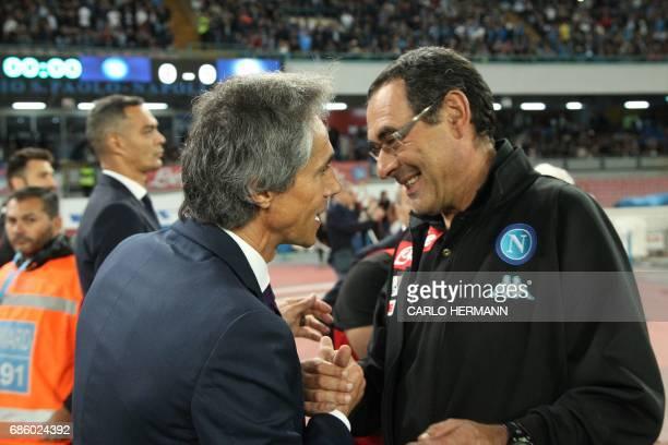 Fiorentina's coach from Portugal Paulo Sousa shakes hands with Napoli's Italian coach Maurizo Sarri before the Italian Serie A football match SSC...