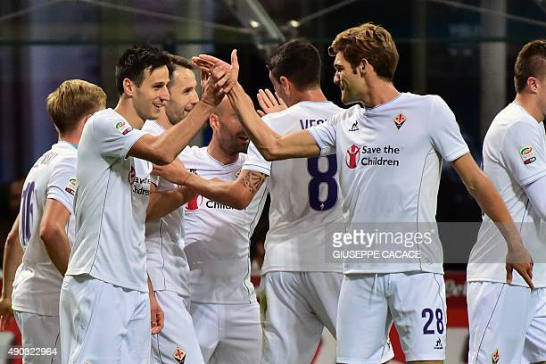 Fiorentina's Croatian forward Nikola Kalinic celebrates with teammates after scoring a goal during the Serie A football match between Inter Milan and...