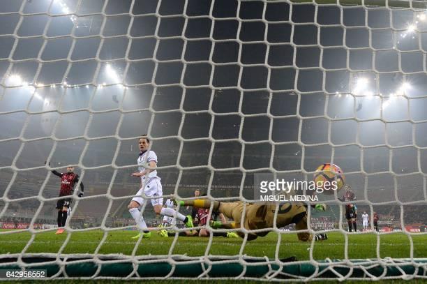 Fiorentina's Croatian forward Nikola Kalinic scores during the Italian Serie A football match between AC Milan and Fiorentina at the San Siro Stadium...