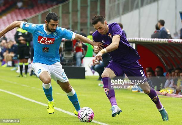 Fiorentina's Croatian forward Nikola Kalinic vies with Napoli's Spanish defender Raul Albiol during the Italian Serie A football match SSC Napoli vs...