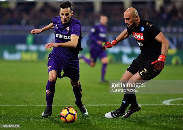 Fiorentina's Croazian forward Nikola Kalinic vies for the ball with Napoli's Spanish goalkeeper Pepe Reina during the Italian Serie A football match...
