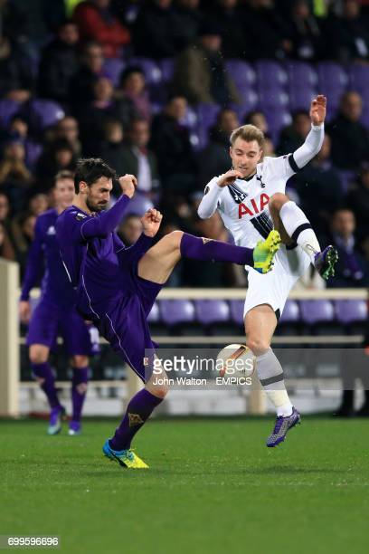 Fiorentina's Davide Astori and Tottenham Hotspur's Christian Eriksen battle for the ball
