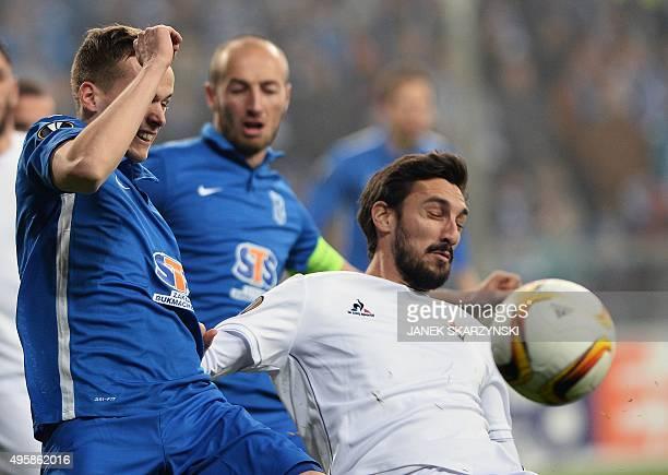 Fiorentina's Davide Astori vies for the ball with KKS Lech Poznan's Tomasz Kedziora during the UEFA Europa League football match KKS Lech Poznan vs...