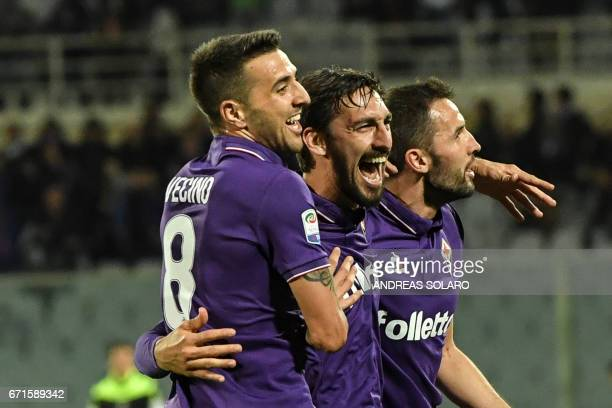 Fiorentina's defender from Italy Davide Astori celebrates with teammates after scoring during the Italian Serie A football match Fiorentina vs Inter...