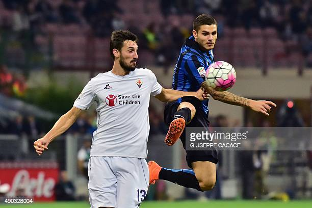 Fiorentina's defender from Italy Davide Astori fights for the ball with Inter Milan's forward from Argentina Mauro Icardi during the Serie A football...