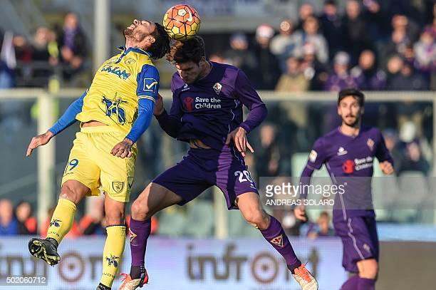 Fiorentina's defender from Spain Marcos Alonso Mendoza fights for the ball with Chievo's midfielder from Argentina Lucas Nahuel Castro during the...