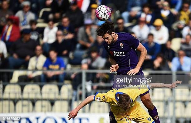 Fiorentina's defender from Spain Marcos Alonso Mendoza heads the ball with Frosinone's defender from Italy Matteo Ciofani during the Italian Serie A...