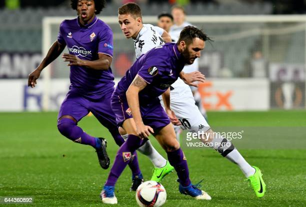 Fiorentina's defender Gonzalo Rodriguez works around Moenchengladbach's midfielder Thorgan Hazard during the UEFA Europa League round of 32 secondleg...