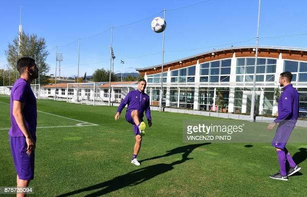 Fiorentina's defender Vincent Laurini from France plays with teammates Fiorentina's midfielder from France Valentin Eysseric and Fiorentina's forward...