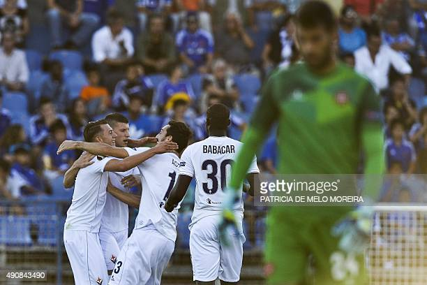 Fiorentina's forward Federico Bernardeschi celebrates with his teammates after scoring against Os Belenenses during the UEFA Europa League Group I...