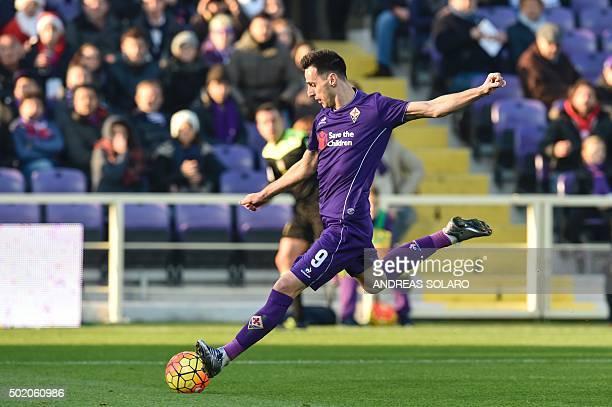 Fiorentina's forward from Croatia Nikola Kalinic kicks the ball during the Italian Serie A football match Fiorentina vs Chievo on December 20 2015 at...