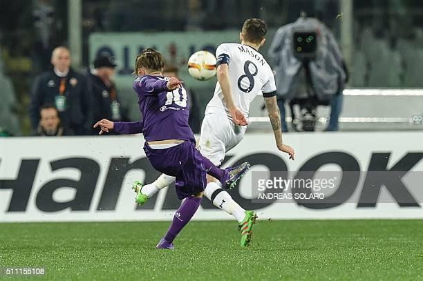 Fiorentina's forward from Italy Federico Bernardeschi shoots and scores during the UEFA Europa League football match Fiorentina vs Tottenham on...