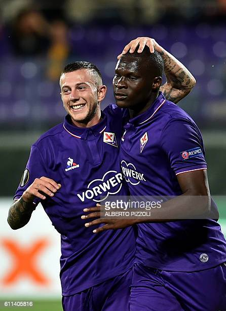 Fiorentina's forward from Senegal Khouma Babacar celebrates with teammate Federico Bernardeschi after scoring during the Europa League football match...