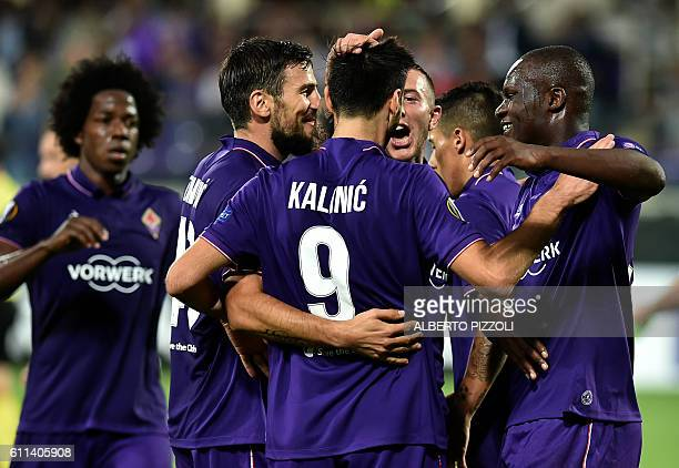 Fiorentina's forward from Senegal Khouma Babacar celebrates with teammates after scoring during the Europa League football match between Fiorentina...