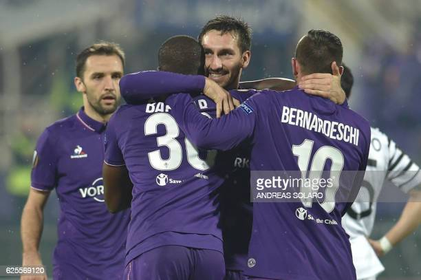 Fiorentina's forward from Senegal Khouma Babacar celebrates with teammates after scoring during the round qualifying UEFA Europa League football...