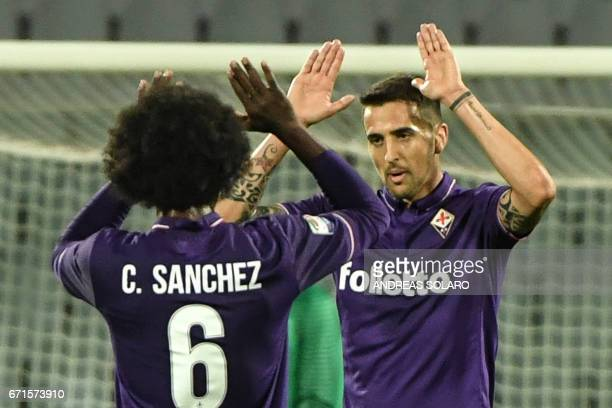 Fiorentina's forward from Uruguay Matias Vecino celebrates with teammate Fiorentina's midfielder from Colombia Carlos Sanchez after scoring during...