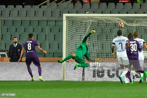 Fiorentina's forward from Uruguay Matias Vecino shoots and scores during the Italian Serie A football match Fiorentina vs Inter Milan on April 22...