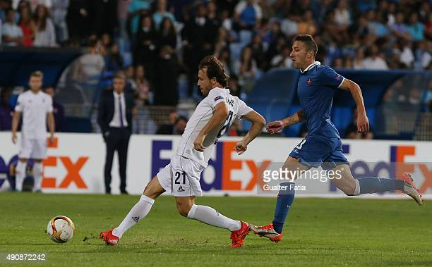 Fiorentina's forward Joan Verdu with Os Belenenses' midfielder Andre Sousa in action during the UEFA Europa League match between Os Belenenses and...
