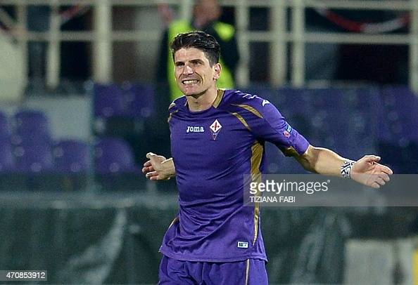 Fiorentina's German forward Mario Gomez celebrates after scoring a goal during the UEFA Europa League second leg quarterfinal football match between...