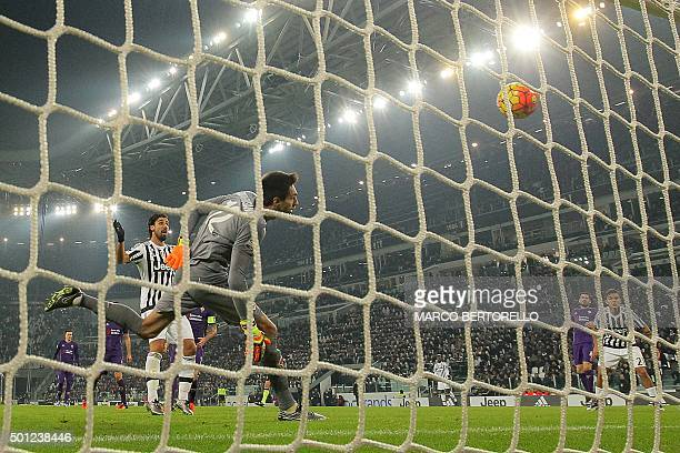 Fiorentina's goalkeeper Ciprian Tatarusanu from Romania eyes the ball as Juventus' midfielder Juan Cuadrado from Colombia fails to score during the...