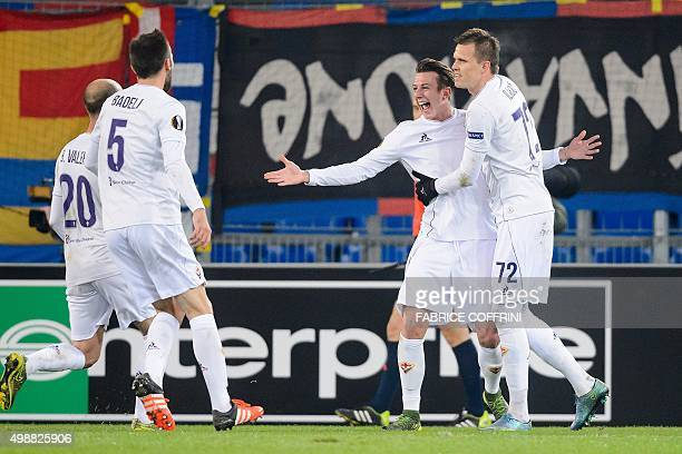 Fiorentina's Italian forward Federico Bernardeschi celebrates with temmates Slovenian midfielder Josip Ilicic Spanish midfielder Borja Valero and...