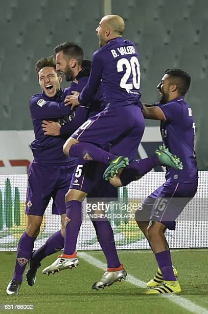Fiorentina's Italian forward Federico Chiesa celebrates with teammates after scoring during the Italian Serie A football match between Fiorentina and...